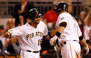 PITTSBURGH - MAY 09:  Neil Walker #18 of the Pittsburgh Pirates celebrates with teammate Ryan Doumit #41 after scoring in the 8th inning against the Los Angeles Dodgers during the game on May 9, 2011 at PNC Park in Pittsburgh, Pennsylvania.  (Photo by Jar