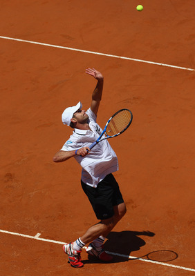 ROME, ITALY - MAY 09:  Andy Roddick of the USA serves during his first round match against Gilles Simon of France during day two of the Internazoinali BNL D'Italia at the Foro Italico Tennis Centre on May 9, 2011 in Rome, Italy.  (Photo by Clive Brunskill