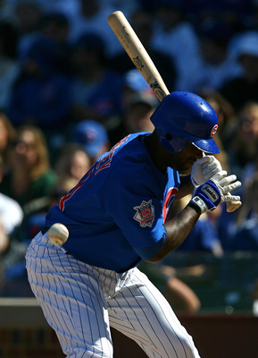 CHICAGO - AUGUST 30: Milton Bradley #21 of the Chicago Cubs is hit by a pitch from Nelson Figueroa of the New York Mets in the 5th inning on August 30, 2009 at Wrigley Field in Chicago, Illinois. (Photo by Jonathan Daniel/Getty Images)