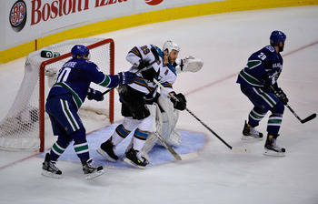 VANCOUVER, CANADA - MAY 15:  Ryan Clowe #29 of the San Jose Sharks and Maxim Lapierre #40 of the Vancouver Canucks vie for position in the crease area in Game One of the Western Conference Finals during the 2011 Stanley Cup Playoffs at Rogers Arena on May