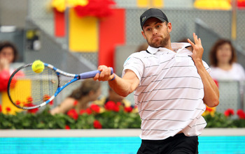 MADRID, SPAIN - MAY 02:  Andy Roddick of USA in action in his match against Flavio Cipolla of Italy during day three of the Mutua Madrilena Madrid Open Tennis on May 2, 2011 in Madrid, Spain.  (Photo by Julian Finney/Getty Images)