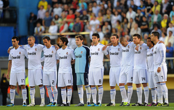 VILLARREAL, SPAIN - MAY 15: Real Madrid players hold a minute of silence in memory of the victims of the recent earthquake in Lorca, Spain before the start of the La Liga match between Villarreal and Real Madrid at estadio El Madrigal on May 15, 2011 in V