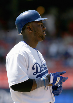 LOS ANGELES - JULY 28:  Milton Bradley #21of the Los Angeles Dodgers looks on the field during the game against the Cincinnati Reds on July 28, 2005 at Dodger Stadium in Los Angeles, California.  The Reds won 6-1. (Photo by Stephen Dunn /Getty Images)