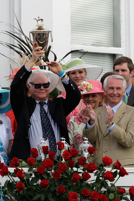 LOUISVILLE, KY - MAY 07:  Barry Irwin, owner of Animal Kingdom riden by John Velazquez, celebrates with the trophy in the winner's circle after they won the 137th Kentucky Derby at Churchill Downs on May 7, 2011 in Louisville, Kentucky.  (Photo by Rob Car