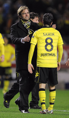SEVILLE, SPAIN - DECEMBER 15:  Head coach Jurgen Klopp of Borussia Dortmund (L) conforts to Nuri Sahin at the end of the UEFA Europa League group J match between Sevilla and Borussia Dortmund at Estadio Ramon Sanchez Pizjuan on December 15, 2010 in Sevill