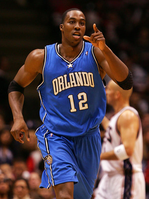 EAST RUTHERFORD, NJ - NOVEMBER 16:  Dwight Howard #12 of the Orlando Magic celebrates a basket against the New Jersey Nets during their game at the Izod Center on November 16, 2007 in East Rutherford, New Jersey.The Magic defeated the Nets 95-70. NOTE TO