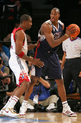 LAS VEGAS - FEBRUARY 18:  Dwight Howard #12 of the Eastern Conference looks for an open pass over  Amare Stoudemire #1 of the Western Conference during the 2007 NBA All-Star Game on February 18, 2007 at Thomas & Mack Center in Las Vegas, Nevada.  NOTE TO