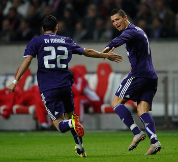 AMSTERDAM, NETHERLANDS - NOVEMBER 23:  Cristiano Ronaldo of Real Madrid celebrates the third goal with Angel Di Maria during the UEFA Champions League Group G match between AFC Ajax and Real Madrid at the Ajax Arena on November 23, 2010 in Amsterdam, Neth