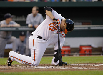 BALTIMORE, MD - MAY 12: Mark Reynolds #12 of the Baltimore Orioles reacts after fouling off a pitch against the Seattle Mariners at Oriole Park at Camden Yards on May 12, 2011 in Baltimore, Maryland.  (Photo by Rob Carr/Getty Images)