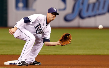 ST. PETERSBURG, FL - APRIL 21:  Shortstop Reid Brignac #15 of the Tampa Bay Rays takes the throw at second against the Chicago White Sox during the game at Tropicana Field on April 21, 2011 in St. Petersburg, Florida.  (Photo by J. Meric/Getty Images)