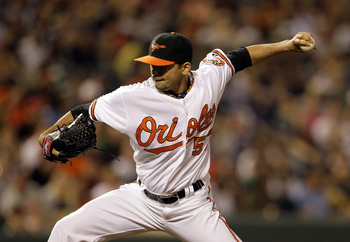 BALTIMORE, MD - APRIL 23:  Pitcher Clay Rapada #57 of the Baltimore Orioles delivers to a New York Yankees batter at Oriole Park at Camden Yards on April 23, 2011 in Baltimore, Maryland.  (Photo by Rob Carr/Getty Images)