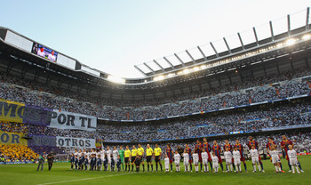 MADRID, SPAIN - APRIL 27:  Players from Real Madrid and Barcelona line up prior to the UEFA Champions League Semi Final first leg match between Real Madrid and Barcelona at Estadio Santiago Bernabeu on April 27, 2011 in Madrid, Spain.  (Photo by Alex Live