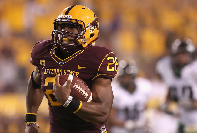 TEMPE, AZ - SEPTEMBER 04:  Runningback Cameron Marshall #26 of the Arizona State Sun Devils rushes the ball for a 38 yard touchdown against the Portland State Vikings during the first quarter of the college football game at Sun Devil Stadium on September