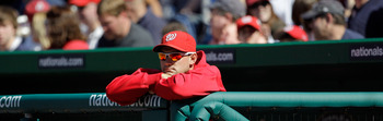 WASHINGTON, DC - APRIL 17:  Ryan Zimmerman #11 of the Washington Nationals looks on from the dugout against the Milwaukee Brewers at Nationals Park on April 17, 2011 in Washington, DC.  (Photo by Rob Carr/Getty Images)