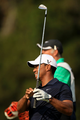 PONTE VEDRA BEACH, FL - MAY 12:  Tiger Woods hits a shot on the fifth hole as caddie Steve Williams looks on during the first round of THE PLAYERS Championship held at THE PLAYERS Stadium course at TPC Sawgrass on May 12, 2011 in Ponte Vedra Beach, Florid