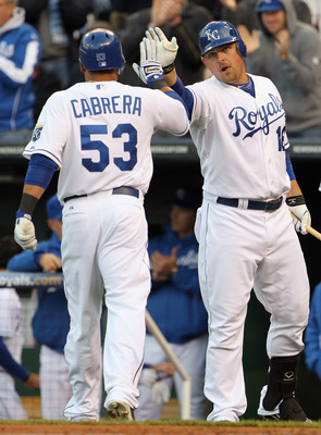 KANSAS CITY, MO - APRIL 20:  Billy Butler #16 of the Kansas City Royals congratulates Melky Cabrera #53 after Cabrera scored on an Alex Gordon triple during the 1st inning of the game against the Cleveland Indians on April 20, 2011 at Kauffman Stadium in