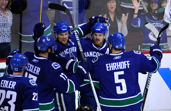 VANCOUVER, CANADA - MAY 18:  (L-R) Alexander Edler #23, Ryan Kesler #17, Henrik Sedin #33, Daniel Sedin #22 and Christian Ehrhoff #5 of the Vancouver Canucks celebrate Daniel Sedin's goal in the third period against the San Jose Sharks in Game Two of the