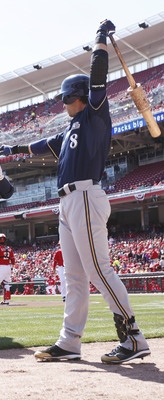 CINCINNATI, OH - APRIL 3: Rickie Weeks #23 of the Milwaukee Brewers celebrates with Ryan Braun #8 after hitting a home run to lead off the game against the Cincinnati Reds at Great American Ball Park on April 3, 2011 in Cincinnati, Ohio. The Reds won 12-3