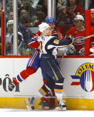 MONTREAL, CANADA - OCTOBER 20:   Steve Begin #22 of the Montreal Canadiens takes a roughing penalty for a punch to the head of Maxim Afinogenov #61 of the Buffalo Sabres during second period action of a game on October 20, 2007 at the Bell Centre in Montr