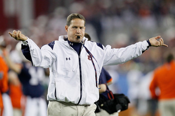 GLENDALE, AZ - JANUARY 10:  Head coach Gene Chizik of the Auburn Tigers reacts on the sideline against the Oregon Ducks during the Tostitos BCS National Championship Game at University of Phoenix Stadium on January 10, 2011 in Glendale, Arizona.  (Photo b