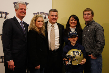 PITTSBURGH - JANUARY 11:  The new University of Pittsburgh head football coach, Todd Graham (center), poses for a photograph with members of his family and University of Pittsburgh athletic director, Steve Pederson (far left), during a press conference on