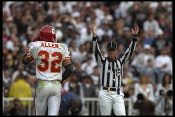 3 Dec 1995:  Running back Marcus Allen #32 of the Kansas City Chiefs scores yet another touchdown against the Oakland Raiders at Oakland Alameda Stadium in Oakland, California.  The Chiefs defeated the Raiders 29-23.    Mandatory Credit:  Al Bello/Allspor