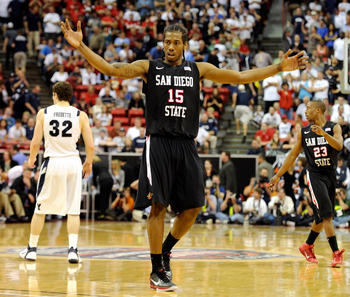LAS VEGAS, NV - MARCH 12:  Kawhi Leonard #15 of the San Diego State Aztecs raises his arms in the last few seconds of the team's 72-54 victory over the Brigham Young University Cougars in the championship game of the Conoco Mountain West Conference Basket