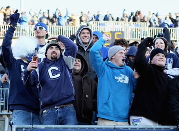 EAST HARTFORD, CT - NOVEMBER 27:  Fans cheer on the Connecticut Huskies as they face the Cincinnati Bearcats on November 27, 2010 at Rentschler Field in East Hartford, Connecticut. The Huskies defeated the Bearcats 38-17.  (Photo by Elsa/Getty Images)