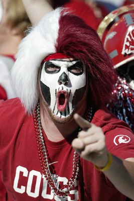 PULLMAN, WA - OCTOBER 21:  A Washington State Cougars fan cheers during the game against the Oregon Ducks on October 21, 2006 at Martin Stadium in Pullman, Washington. Washington State won 34-23. (Photo by Otto Greule Jr/Getty Images)