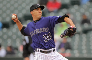 DENVER, CO - MAY 12:  Starting pitcher Ubaldo Jimenez #38 of the Colorado Rockies delivers against the New York Mets at Coors Field on May 12, 2011 in Denver, Colorado.  (Photo by Doug Pensinger/Getty Images)