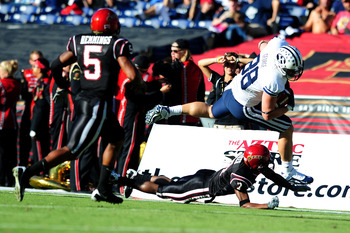 SAN DIEGO - OCTOBER 17:  Andrew George #88 of BYU Cougars runs the ball and avoids getting tackeled by Larry Parker #7 of San Diego State Aztecs at Qualcomm Stadium on October 17, 2009 in San Diego, California. BYU Cougars defeated the Aztecs 38-28  (Phot