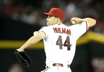 PHOENIX, AZ - APRIL 08:  Relief pitcher Aaron Heilman #44 of the Arizona Diamondbacks pitches against the Cincinnati Reds during the Major League Baseball home opening game at Chase Field on April 8, 2011 in Phoenix, Arizona.  The Diamondbacks defeated th