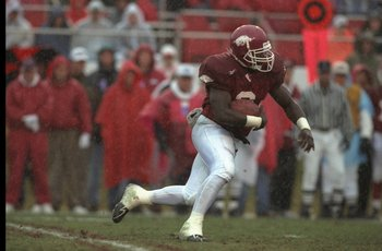 29 Nov 1996: Running back Oscar Malone of the Arkansas Razorbacks moves the ball during a game against the Louisiana State Tigers at the War Memorial Stadium in Little Rock, Arkansas. LSU won the game, 17-7.