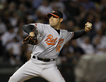 CHICAGO - AUGUST 25: Michael Gonzalez #51 of the Baltimore Orioles pitches against the Chicago White Sox at U.S. Cellular Field on August 25, 2010 in Chicago, Illinois. The Orioles defeated the White Sox 4-2. (Photo by Jonathan Daniel/Getty Images)