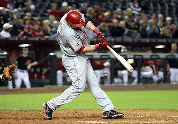 PHOENIX, AZ - APRIL 09:  Jonny Gomes #31 of the Cincinnati Reds hits a 2 RBI double against the Arizona Diamondbacks during the ninth inning of the Major League Baseball game at Chase Field on April 9, 2011 in Phoenix, Arizona.  (Photo by Christian Peters