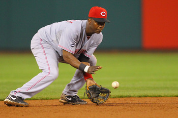 ST. LOUIS, MO - APRIL 22: Edgar Renteria #16 of the Cincinnati Reds fields a ground ball against the St. Louis Cardinals at Busch Stadium on April 22, 2011 in St. Louis, Missouri.  (Photo by Dilip Vishwanat/Getty Images)