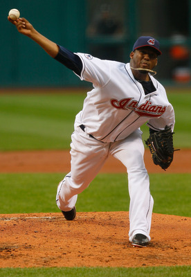 CLEVELAND - MAY 13:  Fausto Carmona #55 of the Cleveland Indians pitches against the Seattle Mariners during the game on May 13, 2011 at Progressive Field in Cleveland, Ohio.  (Photo by Jared Wickerham/Getty Images)