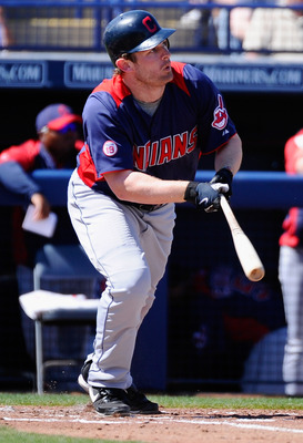 PEORIA, AZ - MARCH 13:  Austin Kearns #26 of the Cleveland Indians hits a double against the San Diego Padres during the second inning of the spring training baseball game at Peoria Stadium on March 13, 2011 in Peoria, Arizona.  (Photo by Kevork Djansezia