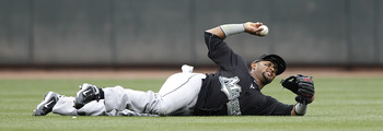 CINCINNATI, OH - MAY 1: Emilio Bonifacio #1 of the Florida Marlins throws the ball after making a diving catch against the Cincinnati Reds at Great American Ball Park on May 1, 2011 in Cincinnati, Ohio. The Marlins defeated the Reds 9-5. (Photo by Joe Rob