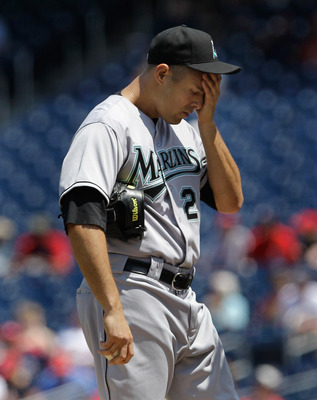 WASHINGTON, DC - MAY 15:  Starting pitcher Javier Vazquez #23 of the Florida Marlins reacts on the mound after giving up two runs to the Washington Nationals during the first inning at Nationals Park on May 15, 2011 in Washington, DC.  (Photo by Rob Carr/