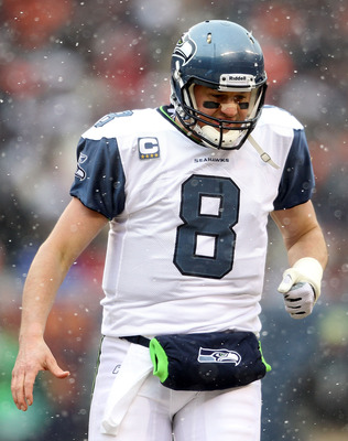 CHICAGO, IL - JANUARY 16:  Quarterback Matt Hasselbeck #8 of the Seattle Seahawks reacts while taking on the Chicago Bears in the 2011 NFC divisional playoff game at Soldier Field on January 16, 2011 in Chicago, Illinois.  (Photo by Andy Lyons/Getty Image
