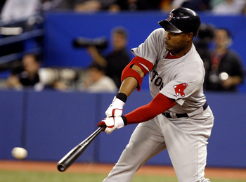 TORONTO, CANADA - MAY 10: Carl Crawford #13 of the Boston Red Sox hits a RBI during MLB action against the Toronto Blue Jays at the Rogers Centre May 10, 2011 in Toronto, Ontario, Canada. (Photo by Abelimages/Getty Images)