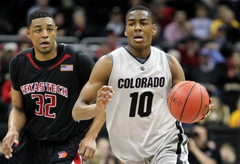 KANSAS CITY, MO - MARCH 10:  Alec Burks #10 of the Colorado Buffaloes moves the ball against Mike Singletary #32 of  the Texas Tech Red Raiders in the first half during the first round game of the 2010 Phillips 66 Big 12 Men's Basketball Tournament at the
