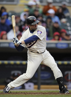 MINNEAPOLIS, MN - MAY 14: Michael Cuddyer #5 of the Minnesota Twins hits a solo home run against the Toronto Blue Jays in the sixth inning on May 14, 2011 at Target Field in Minneapolis, Minnesota. Blue Jays defeated the Twins 9-3 in eleven innings. (Phot