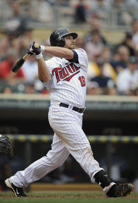 MINNEAPOLIS, MN - MAY 11: Jason Kubel #16 of the Minnesota Twins hits a three-run home run against the Detroit Tigers during in the seventh inning of their game on May 11, 2011 at Target Field in Minneapolis, Minnesota. Tigers defeated the Twins 9-7. (Pho