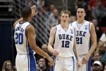 ANAHEIM, CA - MARCH 24:  Andre Dawkins #20, Kyle Singler #12 and Miles Plumlee #21 of the Duke Blue Devils reacts against the Arizona Wildcats during the west regional semifinal of the 2011 NCAA men's basketball tournament at the Honda Center on March 24,