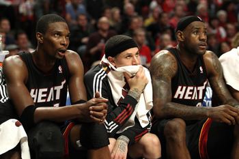 CHICAGO, IL - MAY 15:  (L-R) Chris Bosh #1, Mike Bibby #0 and LeBron James #23 of the Miami Heat look on dejected from the bench late in the fourth quarter in Game One of the Eastern Conference Finals during the 2011 NBA Playoffs on May 15, 2011 at the Un
