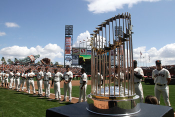 SAN FRANCISCO, CA - APRIL 08:  The 2010 World Series trophy is displayed as San Francisco Giants players line up before the start of the Giants' opening day game against the St. Louis Cardinals at AT&T Park on April 8, 2011 in San Francisco, California.