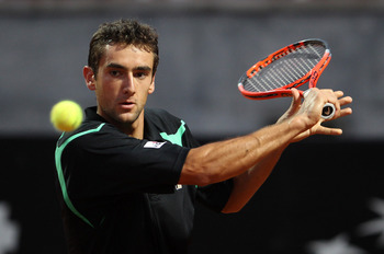 ROME - APRIL 28:  Marin Cilic of Croatia in action against Feliciano Lopez of Spain during day four of the ATP Masters Series - Rome at the Foro Italico Tennis Centre on April 28, 2010 in Rome, Italy.  (Photo by Julian Finney/Getty Images)