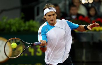 MADRID, SPAIN - MAY 15:  David Ferrer of Spain plays a forehand against Roger Federer of Switzerland in their semi final match during the Mutua Madrilena Madrid Open tennis tournament at the Caja Magica on May 15, 2010 in Madrid, Spain.  (Photo by Clive B